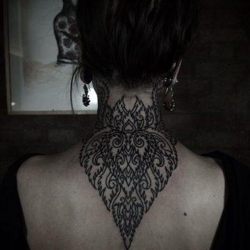 Tatouage dos femme : 50+ idées de tatouages et leurs significations 17