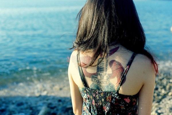 Tatouage dos femme : 50+ idées de tatouages et leurs significations 106