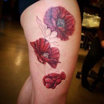 Tatouage cuisse femme : 30+ idées de tatouages et leurs significations 256