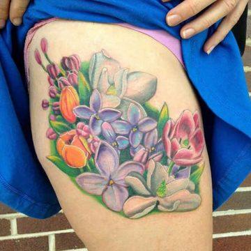 Tatouage cuisse femme : 30+ idées de tatouages et leurs significations 364