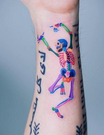 Danse squelette avant-bras tatouage