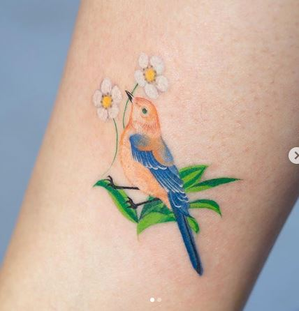 Tatouage Bras Floral Oiseau