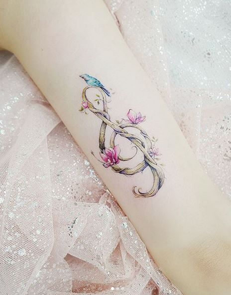 Floral G Clef Arm Tattoo