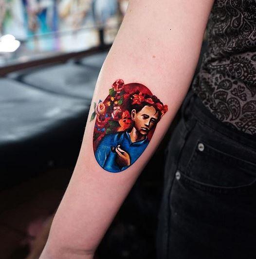 Tatouage avant-bras portrait floral