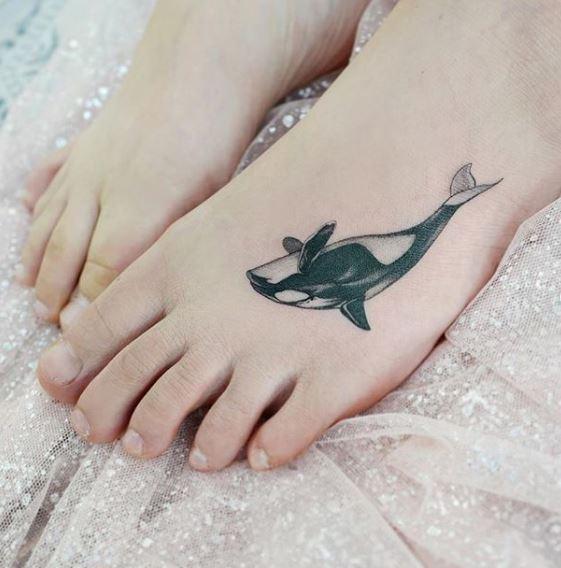 Tatouage de pied d'épaulard