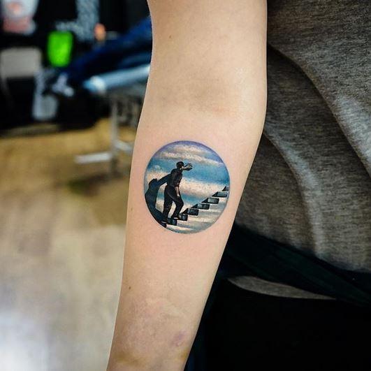 Le tatouage de l'avant-bras Truman Show