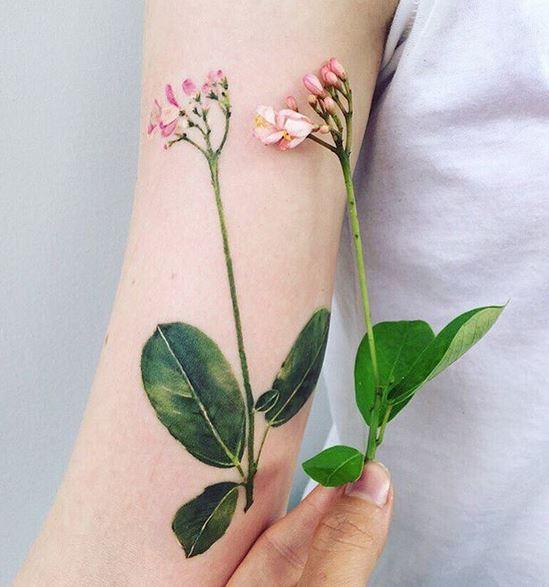 Tatouage Bras Balinais Fleur