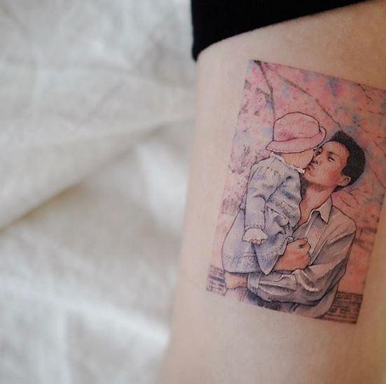 Père et fille bras tatouage