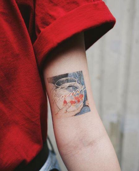 Mini tatouage de bras d'aquarium
