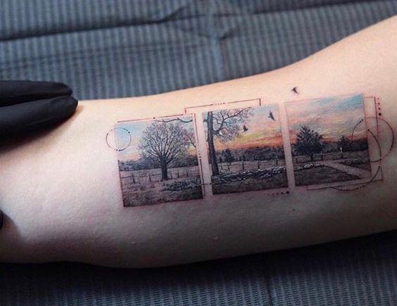 Tatouage de bras de paysage encadré segmenté