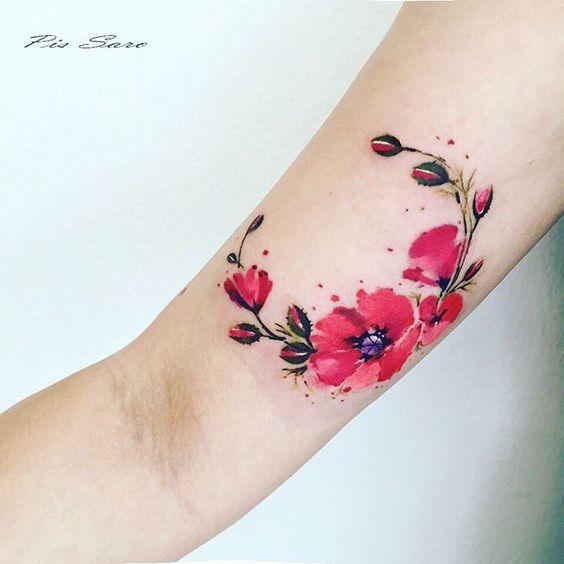Tatouage de bras de pavot aquarelle