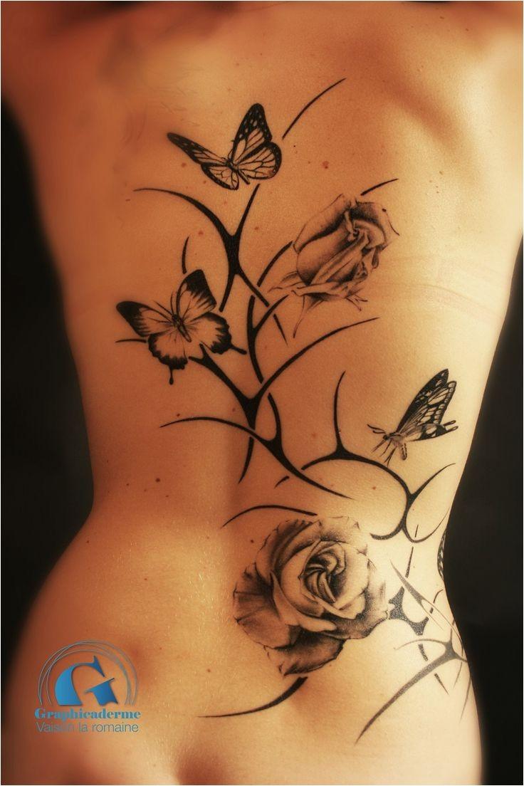 tatouage haut du dos femme papillon 7