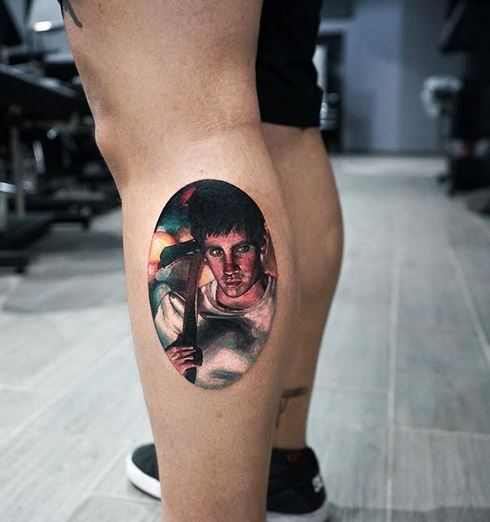 Tatouage de jambe de portrait psycho
